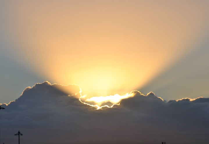 Sunrise coming through the clouds. Of course, in your fiction, it could be absolutely anything