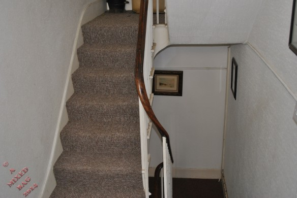 This is the stairwell in my flats, just outside my door. There is the flight ahead on the left going up, and the flight on the right going down