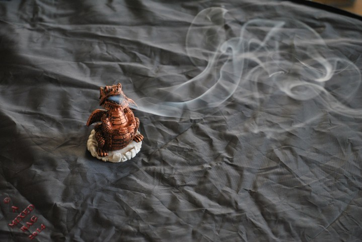 Dragon incense burner with incense coming from the mouth