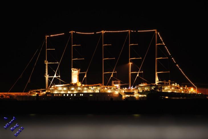 Docked sail cruise ship at night